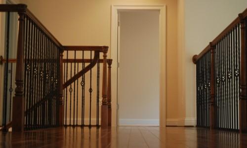 upstairs hall with decorative railings
